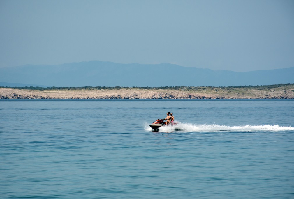 a-couple-riding-a-jet-ski-sea-summer-vacation-fun-adventure-activity-outdoor-recreation_t20_jRjmzk