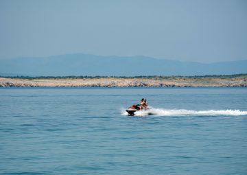 a-couple-riding-a-jet-ski-sea-summer-vacation-fun-adventure-activity-outdoor-recreation_t20_jRjmzk